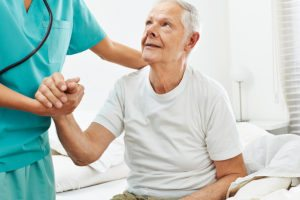 bigstock-Geriatric-caregiver-helping-ol-151540307-300x200 Tips for Caring for a Senior with Lung Cancer