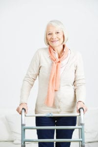 bigstock-Smiling-old-woman-standing-wit-136609598-200x300 What Kinds of Assistance Can Help Prevent Falls?