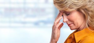 bigstock-Woman-having-migraine-headache-82272656-300x140 How Family Caregivers Successfully Manage Stress