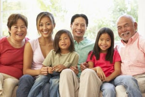 bigstock-Extended-Family-Relaxing-On-So-13907873-300x200 Who Should Be Involved in Family Meetings about Your Senior's Care?